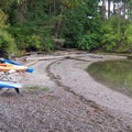Sandy beach shoreline along the hiking trail.- Sucia Island Hiking Trail System