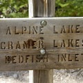 Trail sign at Flatrock Junction.- Alpine Lake + Baron Divide