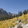 Hiking the Redfish Canyon trail en route to Alpine Lake in September.- Alpine Lake + Baron Divide