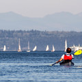 Kayaking toward Port Townsend. Boats in the barckground are part of the Port Townsend Wooden Boat Festival.- Port Townsend Sea Kayaking