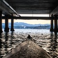 Kayking under the ferry terminal pier.- Port Townsend Sea Kayaking