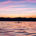 Looking west as the sun sets over the Quimper Peninsula.- Port Townsend Sea Kayaking
