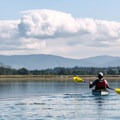Heading southeast with the foothills of the Olympic Mountians in the distance.- Dungeness Bay Sea Kayaking