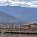 Looking southwest at a floating pen with Happy Lake Ridge in the background.- Port Angeles Harbor Sea Kayaking