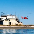 A Coast Guard helicpoter takes off from the Port Angeles Coast Guard Air Station.- Port Angeles Harbor Sea Kayaking