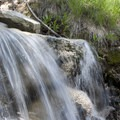 Small waterfall/stream crossing along the Alpine Way Trail.- Alpine Way Trail, Iron Creek to Stanley Lake