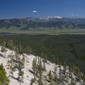 A view of the White Cloud peaks from a ridge accessed via the Alpine Way Trail.  The trail traverses the dense forests in the middle of the photo with virtually no views.- Alpine Way Trail, Redfish to Huckleberry Creek