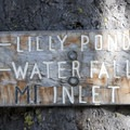 Trail sign to the Lily Pond and Waterfall trail junction.- Alpine Way Trail, Redfish to Huckleberry Creek