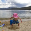 Playing in the sand at the Alturas Lake inlet beach.- Alturas Lake Trail