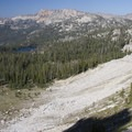 A hiker descends from the Spangle divide to several unnamed lakes above Ardeth Lake.- South Fork of the Payette River, Ardeth Lake and the Spangle Divide