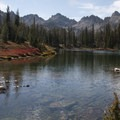 Fall colors decorate the shore of Alice Lake.- Alice + Twin Lakes Hike