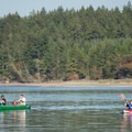 Boaters paddle near Hope Island, a popular stopping spot to wait for tides to change for the return trip.- Hammersley Inlet Sea Kayaking