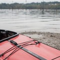 Preparing to catch the outgoing tide from the Oakland Bay Marina.- Hammersley Inlet Sea Kayaking