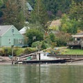 Houses line the shores of Hammersly Inlet for the first few miles.- Hammersley Inlet Sea Kayaking