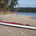 A kayak sits on the beach at Hope Island.- Hope Island State Park Sea Kayaking