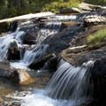 Benedict Creek pours over granite slabs.- South Fork of the Payette River, Benedict, Rock Slide, Three-Island Lakes + Ingleborg Divide