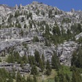 Granite spires and faces along the north side of the South Fork of the Payette Trail upstream of Elk Lake.- South Fork of the Payette River, Benedict, Rock Slide, Three-Island Lakes + Ingleborg Divide
