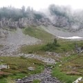 The cloud-filled basin on the other side of Bumblebee Pass.- Mount Thompson: West Ridge