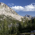 Looking down canyon at Payette Peak (left, 10,221') and the Snowyside massif (low right of center).- South Fork of the Payette River, Hidden Lake and Cramer Divide