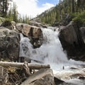 Beyond the Ardeth Lake junction, the forest is pretty thick with a notable absence of views except for this one opening along the creek.- South Fork of the Payette River, Hidden Lake and Cramer Divide