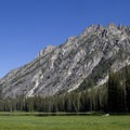 Elk Lake and the granite spire-studded north wall of the South Fork canyon.- South Fork of the Payette River, Taylor Springs to Elk Lake