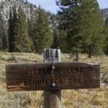 Trail sign at the Neinmeyer Creek junction 5.6 miles up the Little Queens Canyon.- Little Queens River - Browns Lake