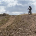 Mountain bikers cresting a hill.- Los Peñasquitos Canyon Preserve