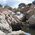 The waterfall is obscured by boulders.- Los Peñasquitos Canyon Preserve