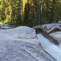 Looking across Slot Falls where the entire flow of the river (at low water) runs through this 4-foot wide crack in the granite bedrock.- South Fork of the Payette River, Taylor Springs to Elk Lake