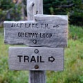 Junction signage at the loop trail and the unmaintained trail to the upper meadow, tarn, and saddle.- Canyon Creek Meadows
