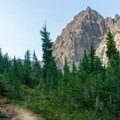 A view of Three Fingered Jack heading toward the tarn.- Canyon Creek Meadows