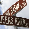 Road sign at the junction of the Queens River Road (205) and the China Basin Road (206).- China Basin Road
