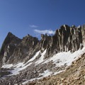 The granite spires of The Temple tower over the switchbacks that lead to the Cramer Divide.- Cramer Lakes + Divide