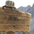 Weather-worn sign at the top of the Cramer Divide.- Cramer Lakes + Divide