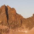 The west face of Mount Sevy and the Arrowhead lit up by the afternoon sun.- Cramer Lakes + Divide