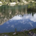 A few small, unnamed lakes dot the alpine basin above Cramer Lakes.- Cramer Lakes + Divide