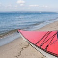 A kayak rests on the shore of Golden Gardens Park in Seattle.- Golden Gardens to Hedley Spit, Bainbridge Island