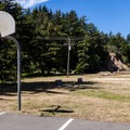 Basketball and volleyball courts in the day use area just south of the beach.- Sunset Bay State Park