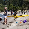 The broad, sandy beach is protected from significant waves, making it a great choice for families.- Sunset Bay State Park