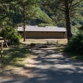 Lower restrooms and a typical site at Humbug Mountain State Park Campground.- Humbug Mountain State Park Campground