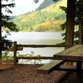 A lakeside picnic table in the campground.- Silver Lake Park