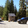 Pay station and vault toilets at the parking lot and trailhead of Heather Lake Trail.- Heather Lake Trail