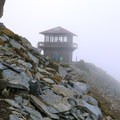 Mount Freemont Lookout Tower at an elevation above 7,000 feet as clouds roll in.- Mount Fremont Lookout Trail