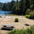 A small, sandy beach is easily accessible from the parking area.- Lake Marie