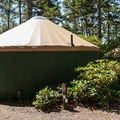 One of the deluxe yurts available at A typical site in Umpqua Lighthouse State Park Campground.- Umpqua Lighthouse State Park Campground