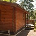 A cabin in Umpqua Lighthouse State Park.- Umpqua Lighthouse State Park Campground