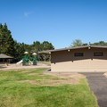Restrooms, day use pavilion, and playground in William M. Tugman State Park.- William M. Tugman State Park