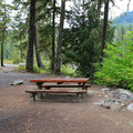 Typical site with a picnic table and a grill.- Red Mountain Campground