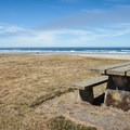 A lone picnic table at Seven Devils State Recreation Site.- Seven Devils State Recreation Site, Merchant Beach