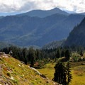 A hiker descends the Railroad Grade Trail.- Railroad Grade Trail